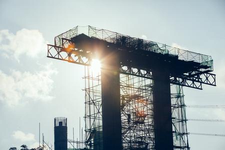 Construction of a highway bridge in the sunrise Archivio Fotografico