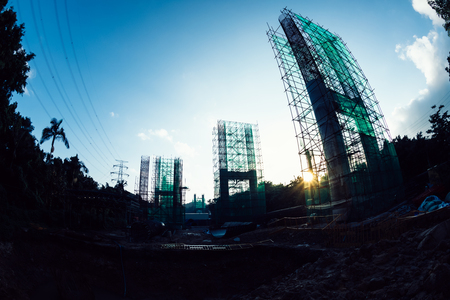 Construction site of a highway bridge in the sunrise