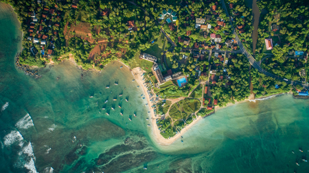aerial view of tropical coastline and fisherman village