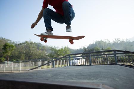 Skateboarder skateboarding at skatepark ramp