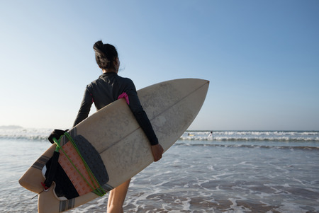 Woman surfer with surfboard going to surf Stock fotó