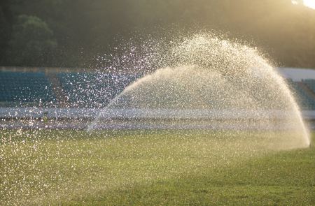 watering lawn in the sunrise stadium Stock Photo