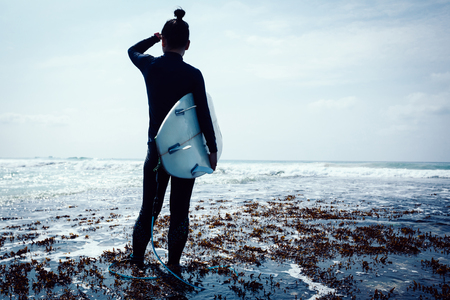 Woman surfer with surfboard going to surf Stok Fotoğraf