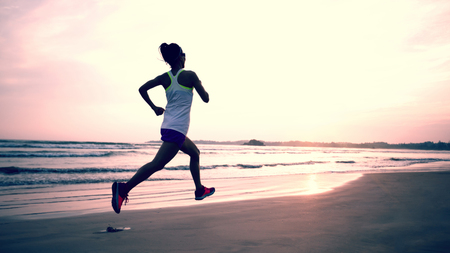 young fitness woman running at beach 스톡 콘텐츠