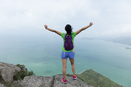 Successful Woman Hiker feel free In Seaside Mountain Top