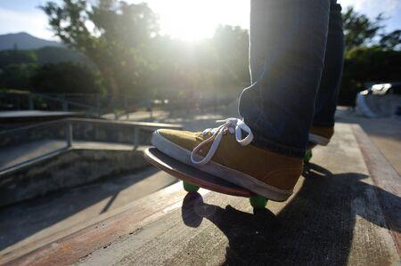 Skateboarder skateboarding on skate park