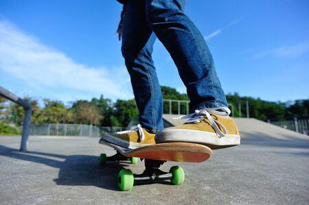 Skateboarder skating at skatepark