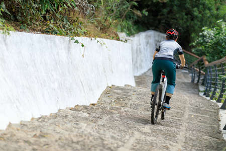 Woman freerider riding down stairs. Sports extreme and active lifestyle