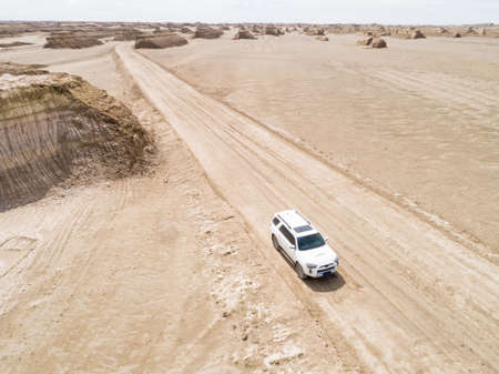 Driving off road car in yardang landform desert in west of China