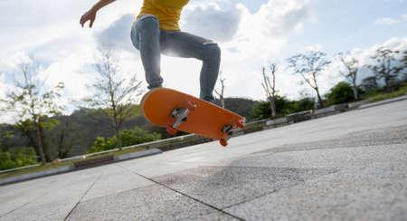Skateboarder skateboarding outdoors in the morning Banco de Imagens