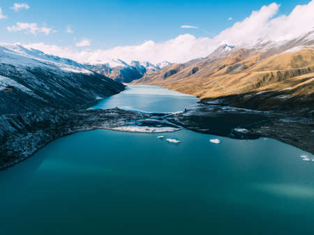 Aerial view of glacier lagoon and snow mountains in Tibet,China Banco de Imagens