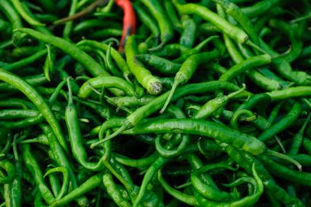 Fresh chilli pepper selling at agriculture market Banco de Imagens
