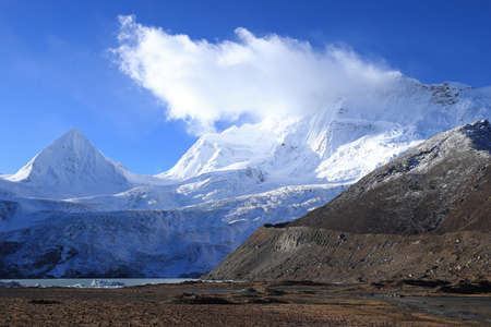 Snow mountains under blue sky in tibet,China
