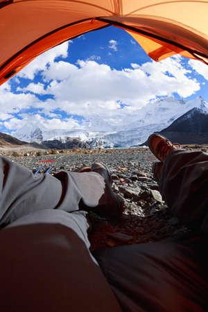 Two hikers enjoy the beautiful landscape in tent Banco de Imagens