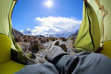 Hiker enjoy the beautiful landscape in tent Banco de Imagens
