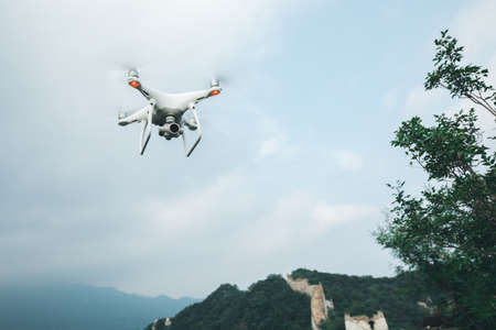 Flying drone taking photo of the great wall landscape in China