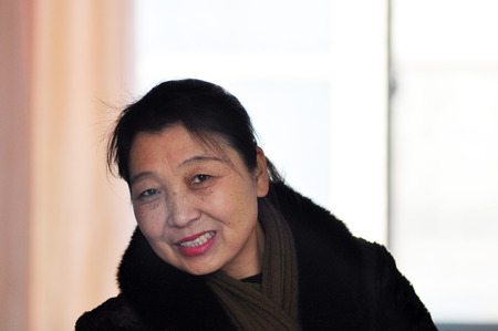 gleeful: Asian middle-aged women