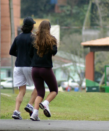 a young couple running                     Stock Photo