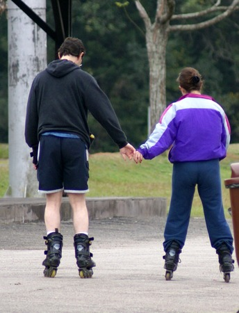 a young couple holding hands                 Stock Photo