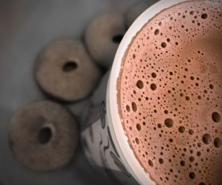 a cup of milk coffee with cookies on background Stock Photo