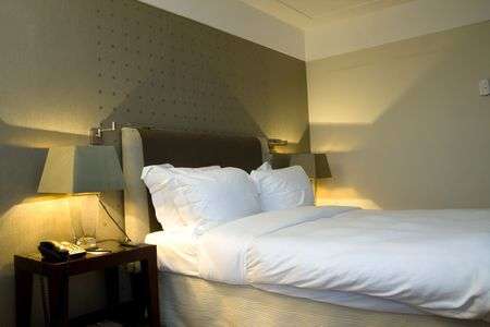 king bed: A welcoming business hotel room.