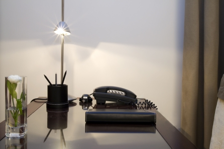 Working desk with lamp and telephone. photo