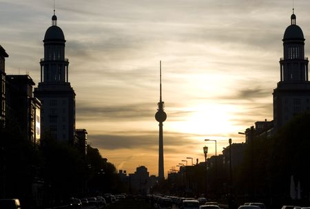 tv tower: Sunset in Berlin with the tower of Frankfurter Tor Stock Photo