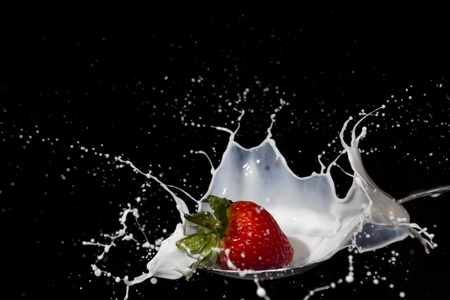 fruit shake: Dropping a strawberry into milk