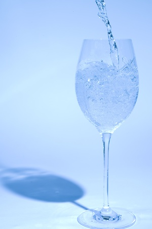 Glass of water isoladed on blue Stock Photo - 8549114