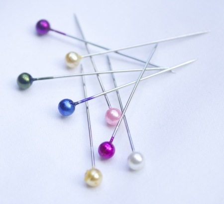 hem: Colourful Sewing Pins Scattered Stock Photo