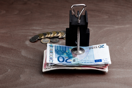 euro screw: Money squeezed in a clamp