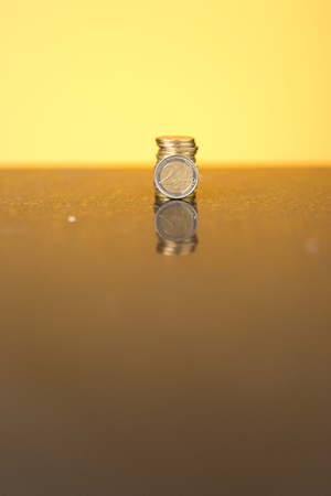 golden glow: Stack of coins with a golden glow
