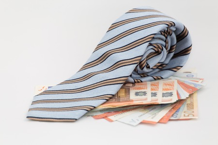 bank notes: A necktie on pile of bank notes: corporate money Stock Photo