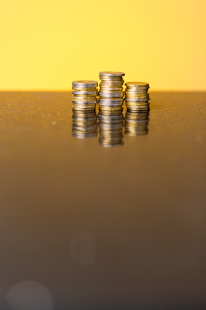 golden glow: Stacks of coins with a golden glow