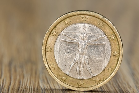 Close up of a one euro coin from the European Union member Italy showing the Vitruvian Man, a drawing by Leonardo da Vinci