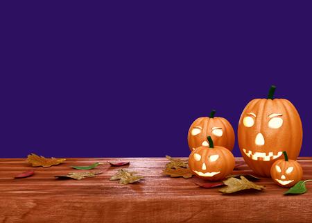 Halloween pumpkin lanterns on wooden desk - 3D render