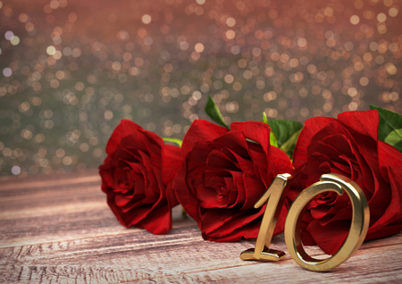 10th: birthday concept with red roses on wooden desk. 3D render - tenth birthday. 10th