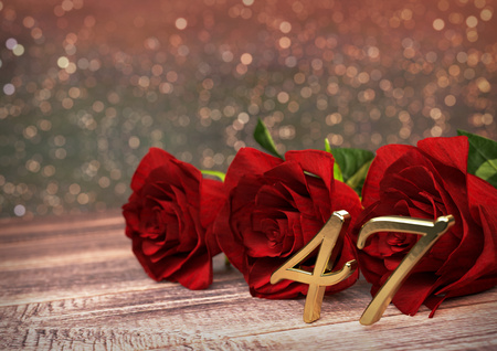 birthday concept with red roses on wooden desk. 3D render - forty-seventh birthday. 47th