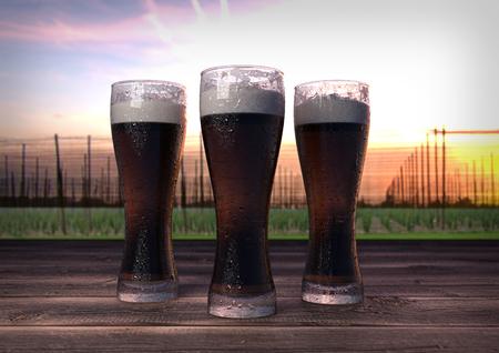 hopgarden: three glasses of dark beer on wooden desk with hop-garden on background- 3D render