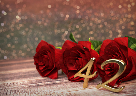 42nd: birthday concept with red roses on wooden desk. 3D render - forty-second birthday. 42nd