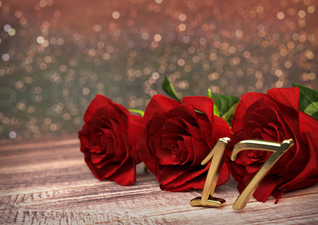 17th: birthday concept with red roses on wooden desk. 3D render - seventeenth birthday. 17th