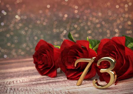 third birthday: birthday concept with red roses on wooden desk. 3D render - seventy-third birthday. 73rd