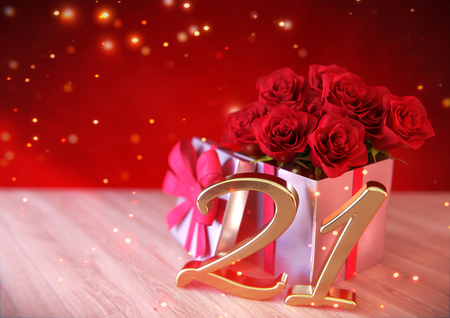 birthday concept with red roses in the gift on wooden desk- twenty-first birthday. 21st Stock Photo