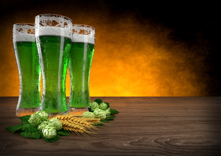 three glasses of green beer with barley and hops. 3D render 스톡 콘텐츠