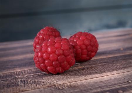 Raspberrieson wooden desk. 3D render