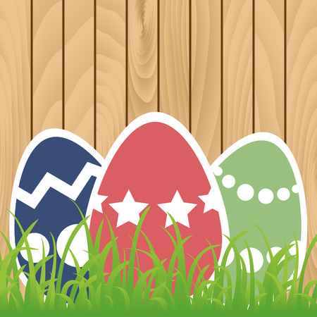 Easter eggs with grass on wooden background