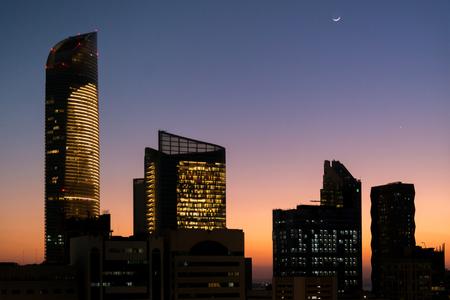 Abu Dhabi city sunset with a beautiful moon Stock Photo