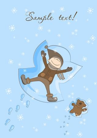 Ni�o feliz haciendo una tarjeta de Navidad de Angel de nieve