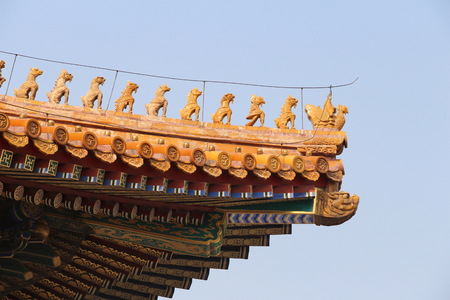 Forbidden city.An area of Beijing, China, that contains the former imperial palaces, to which entry was forbidden to all except the members of the imperial family and their servants. Ornaments and roofs of China.