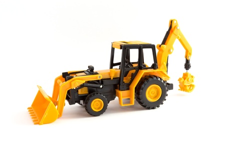 Toy yellow tractor on a white background